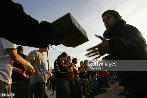 Israeli settlers baricade themselves as they get ready for their expected eviction tomorrow morning on January 31 2006 in the settlement of Amona...