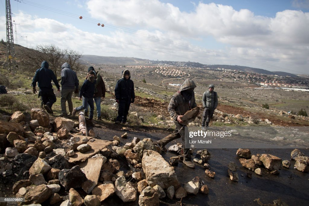 Israeli settlers block an entrance ahead of the upcoming eviction of the illegal Jewish settlement on February 1, 2017 in Amona, West Bank. Israeli Security forces have started evacuating residents from the illegal outpost of Amona in the West Bank on Wednesday, after hundreds of youths streamed into the outpost to fight the evacuation.