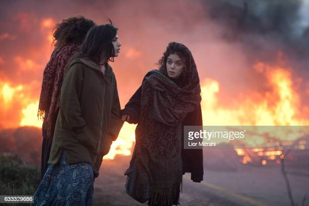 Israeli settlers burn tires and block an entrance ahead of the upcoming eviction of the illegal Jewish settlement on February 1 2017 in Amona West...