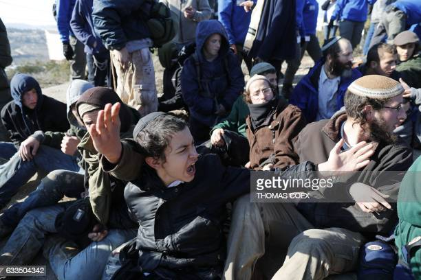 Israeli settlers react as Israeli police mobilise on the second day of an operation to evict the hardline occupants and their supporters from the...