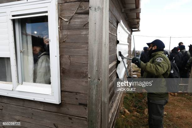 TOPSHOT Israeli settlers remain inside their huts in protest during scuffles with security forces at the Amona outpost northeast of Ramallah on...