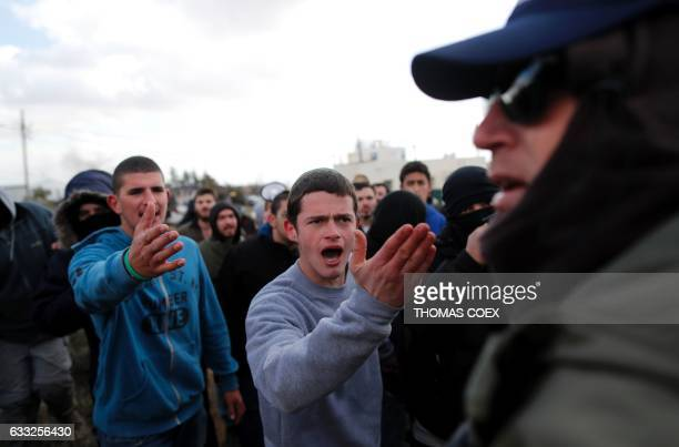 TOPSHOT Israeli settlers scuffle with security forces at the Amona outpost northeast of Ramallah on February 1 2017 as they evict the hardline...