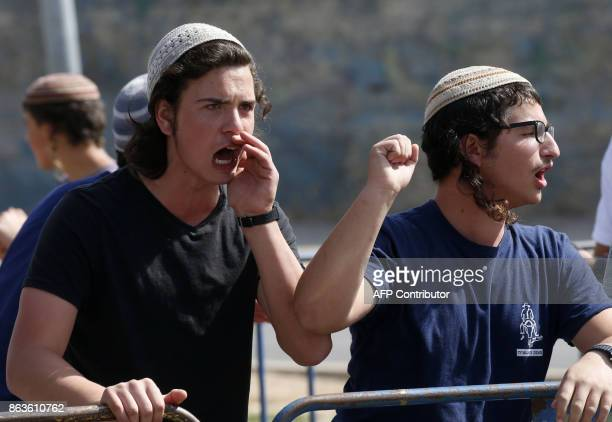 Israeli settlers shout at leftwing Israeli demonstrators in the centre of the divided city of Hebron during a protest called by NGO Peace Now to...