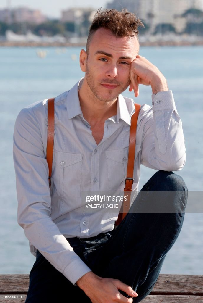 Israeli singer-songwriter and musician Asaf Avidan poses during a photocall as part of the music world's largest annual trade fair, MIDEM on January 26, 2013 in Cannes, southeastern France. The MIDEM music trade show will bring 7,000 of the global industry's biggest players together on the French Riviera for four days. AFP PHOTO / VALERY HACHE