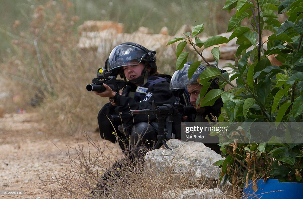 Israeli Solders aim at Palestinian protesters during a protest against the expanding of Jewish settlements in Kufer Qaddom village, near the West Bank city of Nablus. May 6, 2016.