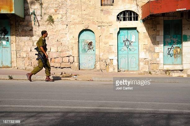 Israeli soldier and graffiti in Hebron