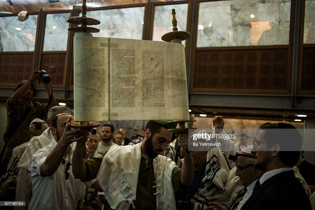 Israeli soldier carrying a torah as Holocoust survivers seen performing a Bar Mitzvah ceremony on May 2, 2016 in Jerusalem, Israel. Ahead of Holocoust remembrance day, a group of survivors were given the oportunity to particpate in a Bar Mitzvah ceronomy decades after the holocoust.