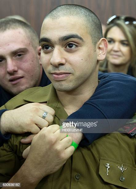 Israeli soldier Elor Azaria who shot dead a wounded Palestinian assailant awaits for the verdict in his case at the military court in Tel Aviv on...
