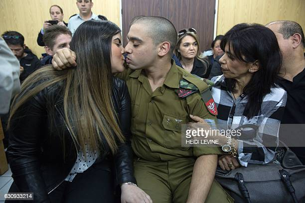 Israeli soldier Elor Azaria who shot dead a wounded Palestinian assailant kisses his girlfriend Orel as he awaits for the verdict in his case at the...
