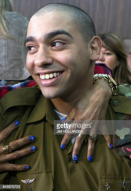 Israeli soldier Elor Azaria who shot dead a wounded Palestinian assailant in March 2016 is embraced by his mother Oshra at the start of his...