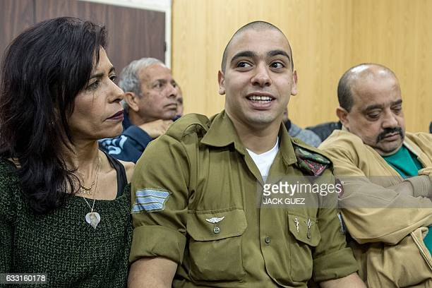 Israeli soldier Elor Azaria who shot dead a wounded Palestinian assailant sits with his mother Oshra and his father Charlie at the military court in...