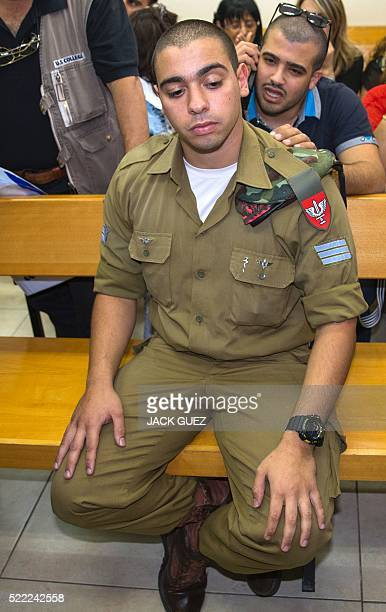 Israeli soldier Elor Azaria who was caught on video shooting a wounded Palestinian assailant in the head as he lay on the ground sits during a...