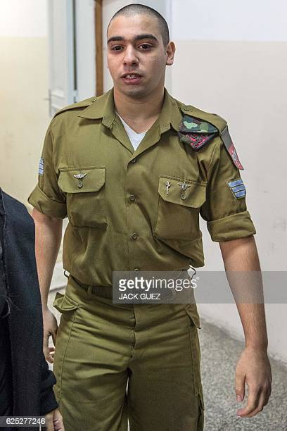 Israeli soldier Elor Azaria who was caught on video shooting a wounded Palestinian assailant in the head as he lay on the ground arrives for a...