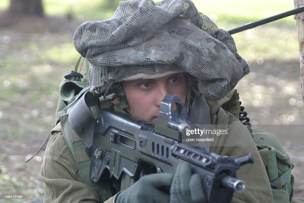 CONTENT] Israeli soldier from the Givatti Brigade on the ground in the Gaza strip during and operation to stop Hamas rocket firing in to Israel.