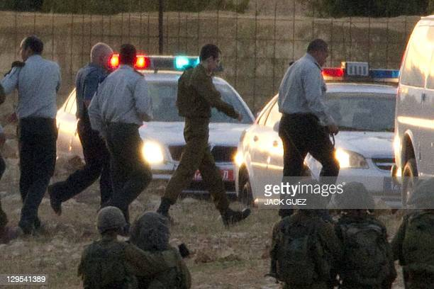 Israeli soldier Gilad Shalit and his father Noam arrive near their home town following Gilad's release after over five years of captivity by...