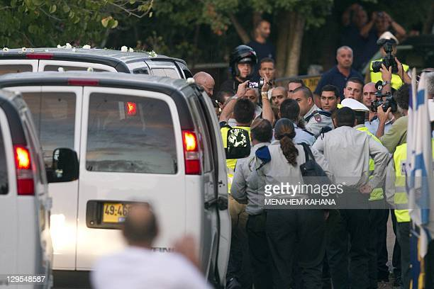 Israeli soldier Gilad Shalit and his father Noam Shalit arrive at their home in Mitzpe Hila following a landmark deal with Hamas which freed Gilad...