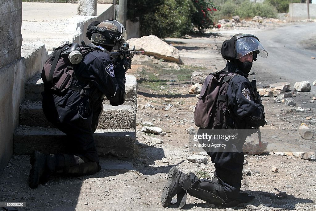 Israeli soldiers aim their weapons towards Palestinian protesters during the clashes following a demonstration against expropriation of Palestinian...