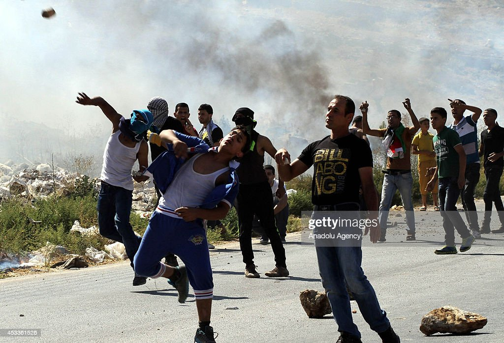 Israeli soldiers and a group of Palestinians protesting in support of Gaza against the Israeli attacks clash near an Israeli check point in Nablus, West Bank on August 8, 2014.