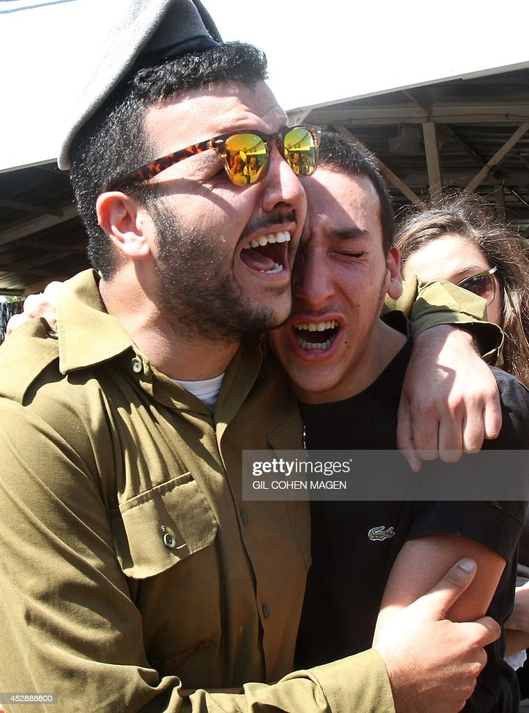 Israeli soldiers and friends mourn during the funeral of Israeli soldier Corporal Meidan Maymon Biton at the cemetery of the southern Israeli city of...