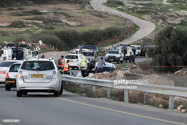 Israeli soldiers and police gather at the scene of an attack near the Jewish settlement of Otniel south of the West Bank town of Hebron on November...