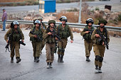 Israeli soldiers are seen during a demonstration on October 7 2015 at the entrance to the village of Beit Sahur West Bank The demonstration was...