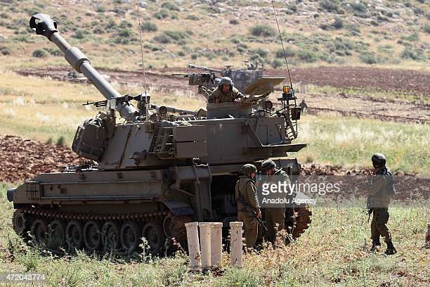 Israeli soldiers are seen near a tank as Israeli troops carry out a military exercise in Aqraba village located in Nablus northen West Bank on May 3...