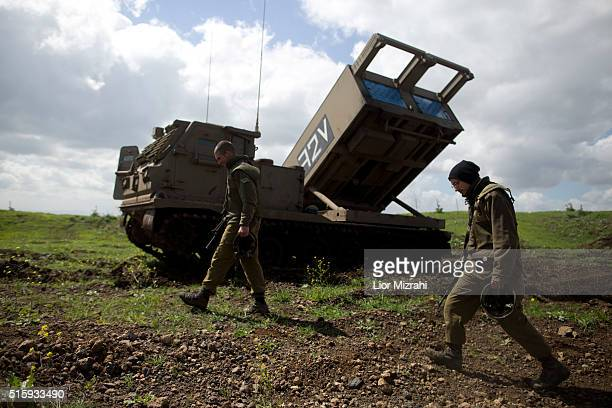 Israeli soldiers are seen next to an M270 Multiple Launch Rocket System during an army drill on March 16 2016 in Israeliannexed Golan Heights Israeli...