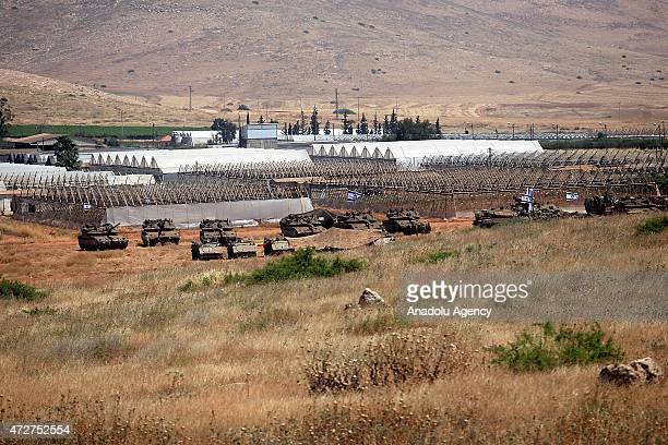 Israeli soldiers are seen on a tank as Israeli army conducts a large scale military drill in northeastern Tubas West Bank on May 6 2015