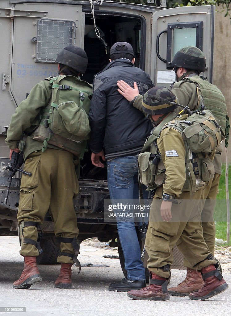 Israeli soldiers arrest a young Palestinian following clashes during a demonstration in support with Palestinian prisoners jailed in Israeli prisons on February 14, 2013 in Nablus, in the occupied West Bank.