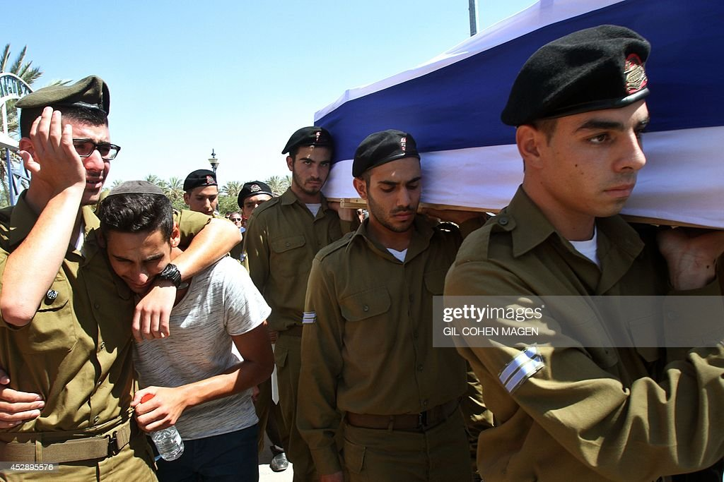 Israeli soldiers carry the coffin of Israeli soldier Corporal Meidan Maymon Biton during his funeral at the cemetery of the southern Israeli city of...