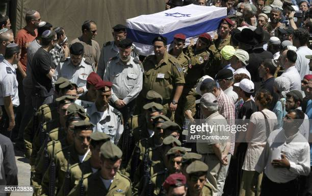 Israeli soldiers carry the coffin of Sgt Yehuda Greenfeld during his funeral at the military cemetery in Jerusalem 07 August 2006 Greenfeld died...