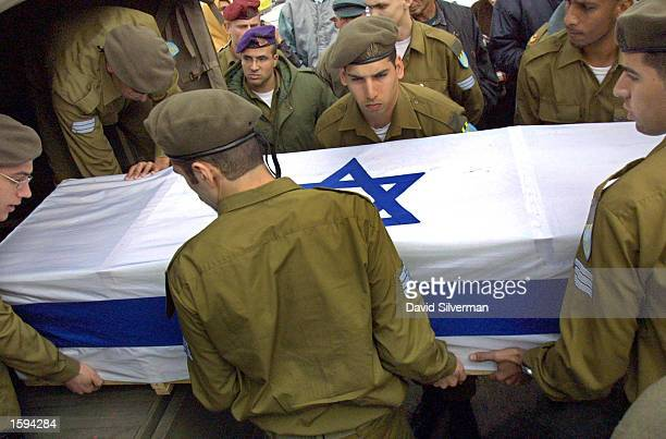 Israeli soldiers carry the flagcovered coffin out of a Command Car at the start of the funeral of 19yearold Israeli army woman Sergeant Kochava...