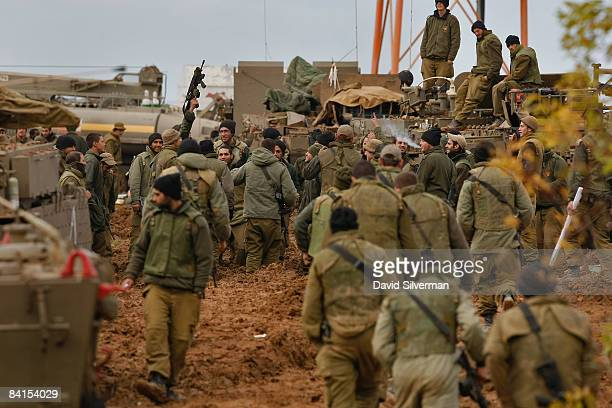 Israeli soldiers celebrate as their unit is deployed to a large armor forward base January 1 2009 near Israel's border with the Hamasrun territory...