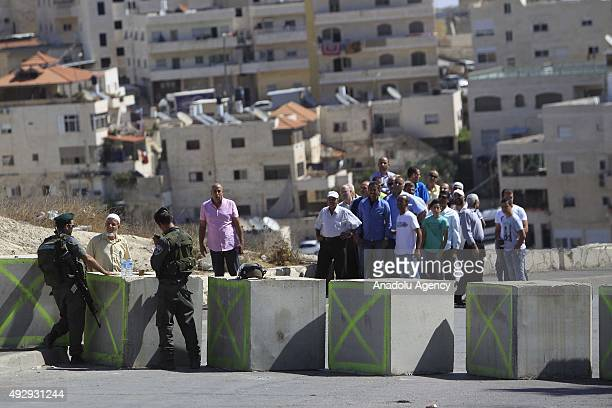 Israeli soldiers check Palestinian worshippers at a checkpoint in Issawiya neighbourhood as Palestinians are on their way to attend the Friday prayer...