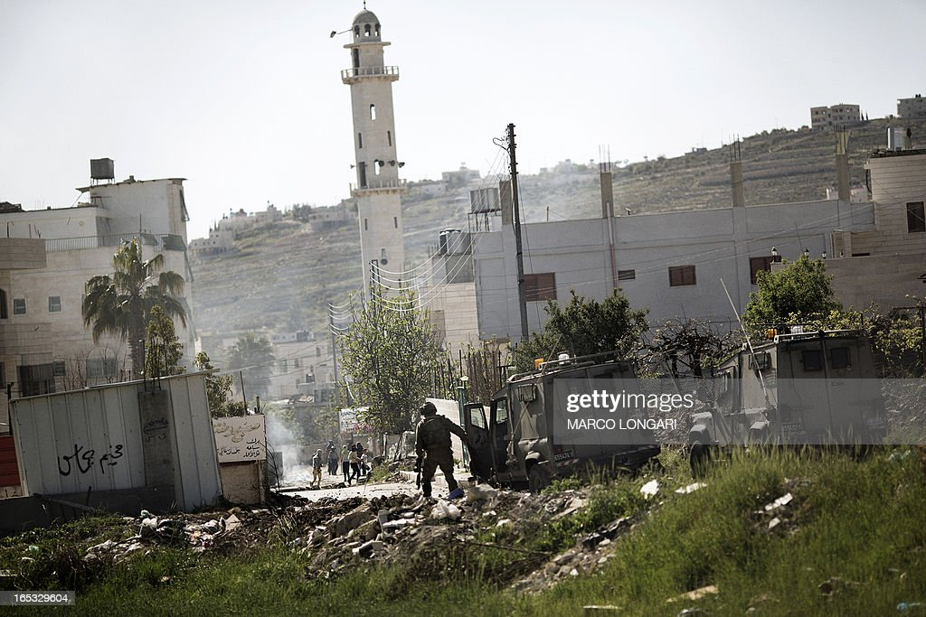 Israeli soldiers clash with Palestinian stone throwers at the al-Arub refugee camp North of the West Bank city of Hebron on April 3, 2013. Defence Minister Moshe Yaalon warned that Israel would respond to any attacks on its territory and not allow its people to come under fire 'in any form'.