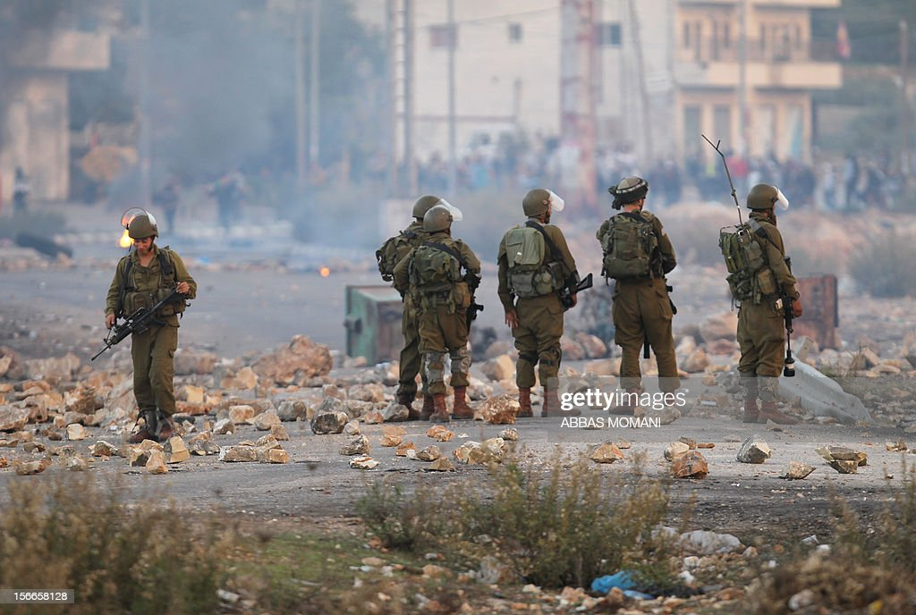 Israeli soldiers clash with Palestinian students from Birzeit University for the second consecutive day as they protest against the ongoing Israeli offensive on the Gaza Strip in the West Bank town of Betunia on November 18, 2012. Israel's Foreign Minister Avigdor Lieberman said that Israel would not negotiate a truce with Gaza Strip's Hamas rulers as long as rocket fire continues from the Palestinian enclave. AFP PHOTO/ABBAS MOMANI