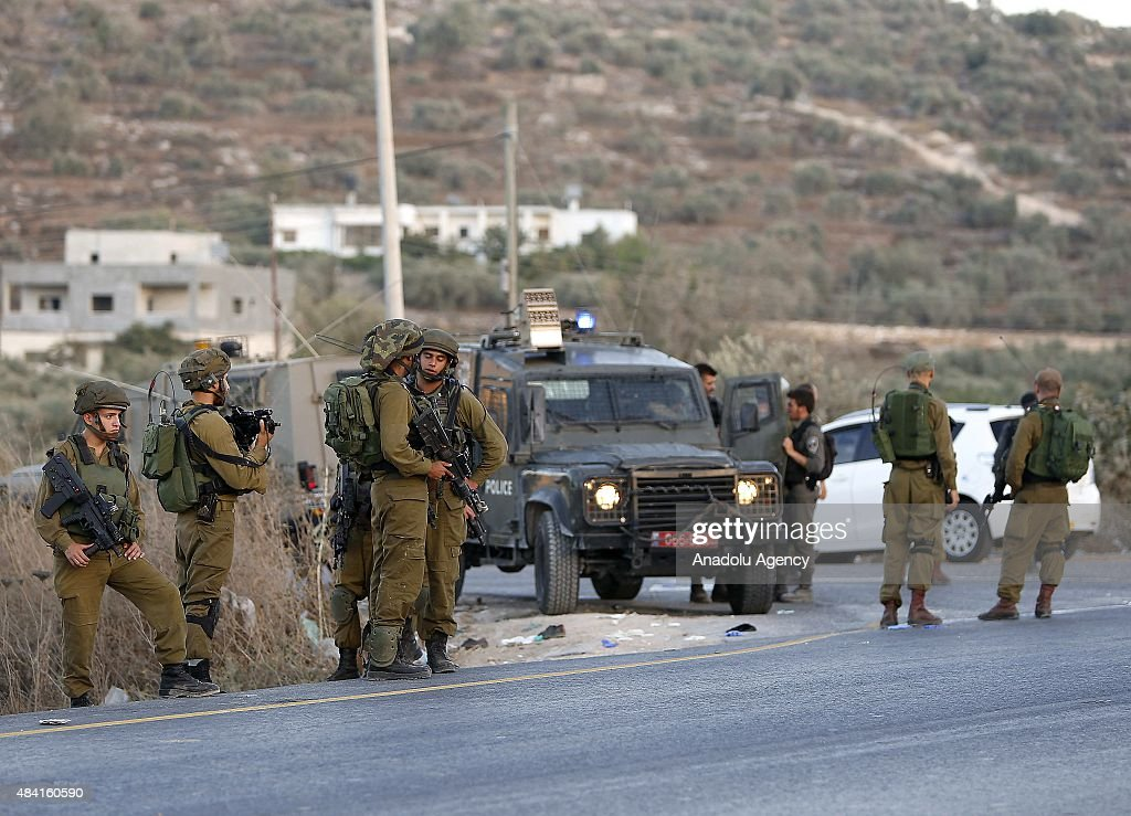 Israeli soldiers close the road near Beta village after Palestinian 21yearold Ahmad Rafiq Taj allegedly stabbed a Border Police officer near the West...