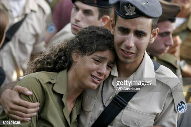Israeli soldiers comfort each other during the funeral of Sgt Nimrod Cohen 19yearsold killed in southern Lebanon yesterday during a military...