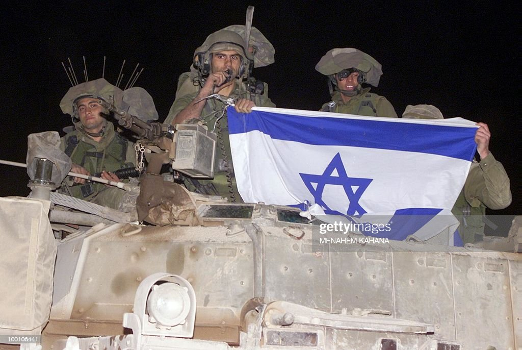 Israeli soldiers crossing the Metulla border-crossing on their way out from Lebanon early May 24, 2000 show the Israeli flag that was raised on the Beaufort Castle, after the Israeli army abandoned its headquarters in southern Lebanon as Israel's 22-year occupation of south Lebanon came to an end. Ten years after withdrawing all its troops from south Lebanon, Israel is still wrestling with the results of the unilateral move which cost the Jewish state dearly in terms of deterrence. In the decade since Israeli troops ended their 22-year occupation of south Lebanon on May 24, 2000, Israel and Hezbollah have fought a bloody war, and the Shiite militia has transformed itself into a well-equipped military force.