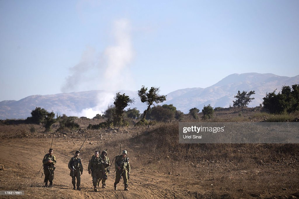 Israeli soldiers during a military exercise on August 29, 2013 near the border with Syria, in the Israeli-annexed Golan Heights. Tension's are rising in Israel amid international talks of a military intervention In Syria.