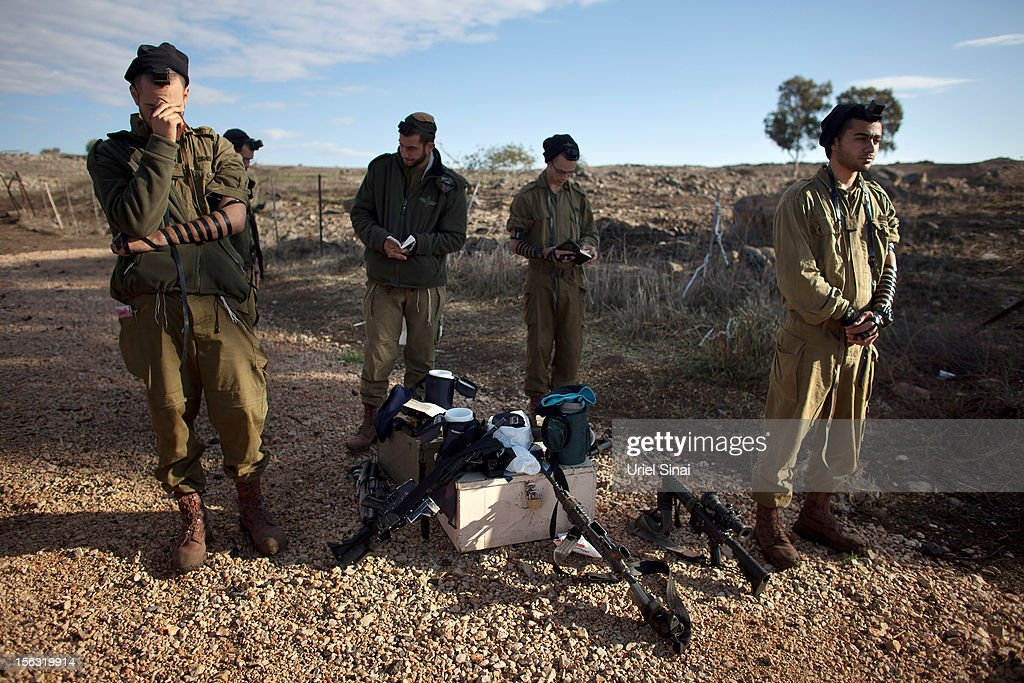 Israeli soldiers during their morning prayer on November 13, 2012 near Alonei Habashan in the Golan Heights. Tension remains high in the disputed Golan Heights after Israeli Defence Forces retaliated after mortar shells were fired into Israeli territory from Syria.