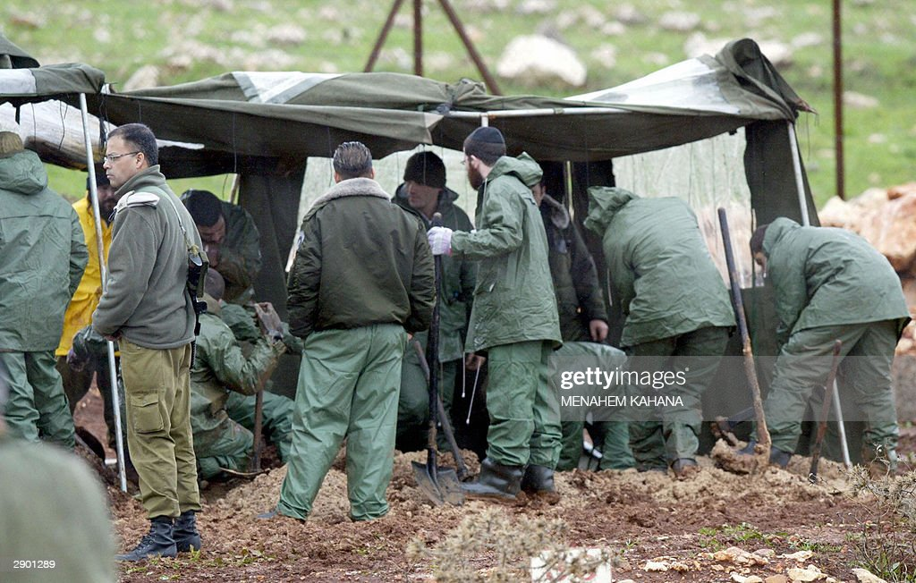 Israeli soldiers exhume the bodies of Arab fighters which will be returned to Lebanon at a graveyard near Kibbutz Amiad in northern Israel 26 January...