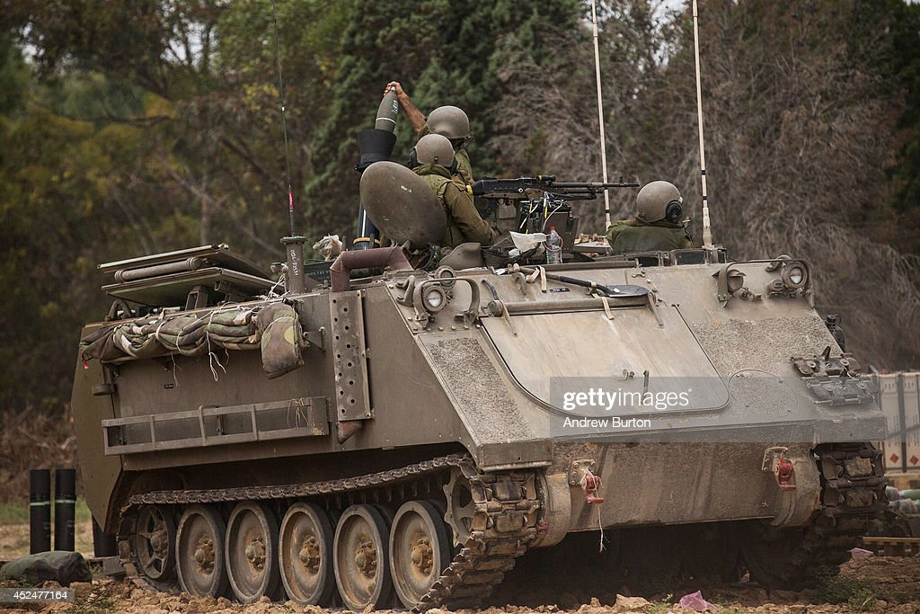 Israeli soldiers fire mortars from an armored personnel carrier near the Israeli-Gaza border during operation 'Protective Edge' on July 21, 2014 near Sderot, Israel. Yesterday marked the bloodiest day of the conflict yet, as 13 Israeli soldiers died and the death toll in Gaza passed 500 people.