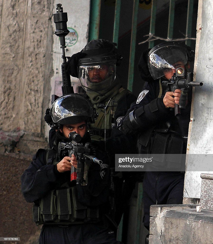 Israeli soldiers fire plastic bullets and tear gas to Palestinians following the funeral of Anas al-Atrash, after he was killed by Israeli soldiers on November 7, 2013 in North Jerusalem. November 8, 2013, Hebron, West Bank.