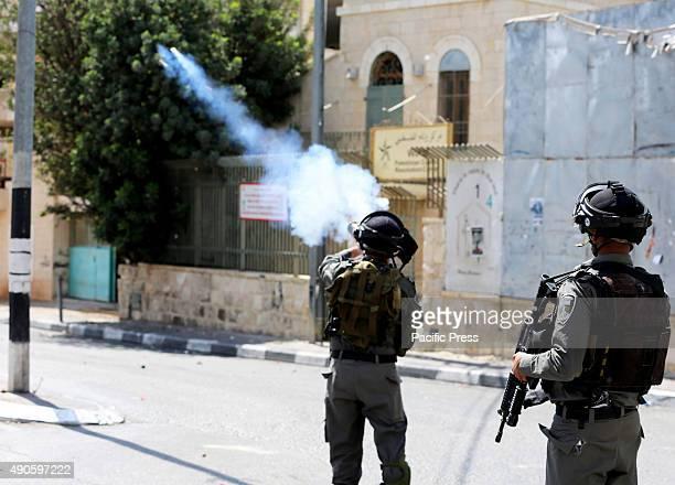 Israeli soldiers fire tear gas into a crowd of demonstrators in the West Bank city of Bethlehem Palestinians in the West Bank city of Bethlehem took...