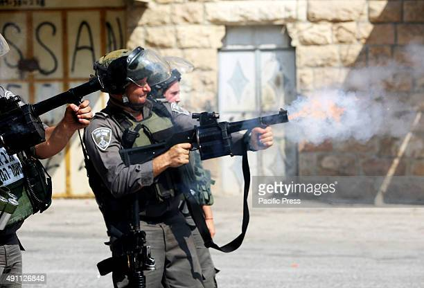 Israeli soldiers fire tear gas into Palestinian demonstrators during a demonstration in the West Bank city of Hebron One day after two Jewish Israeli...