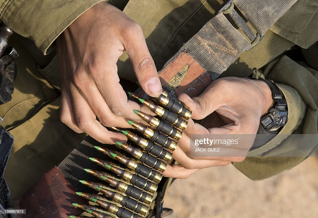Israeli soldiers from a tank squadron prepare ammunition at an Israeli army deployment area near the IsraelGaza Strip border on November 19 2012 The...
