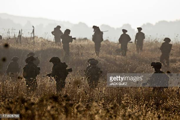 Israeli soldiers from the Golani Brigade take part in a military exercise in the Israeliannexed Golan Heights near the border with Syria on June 26...