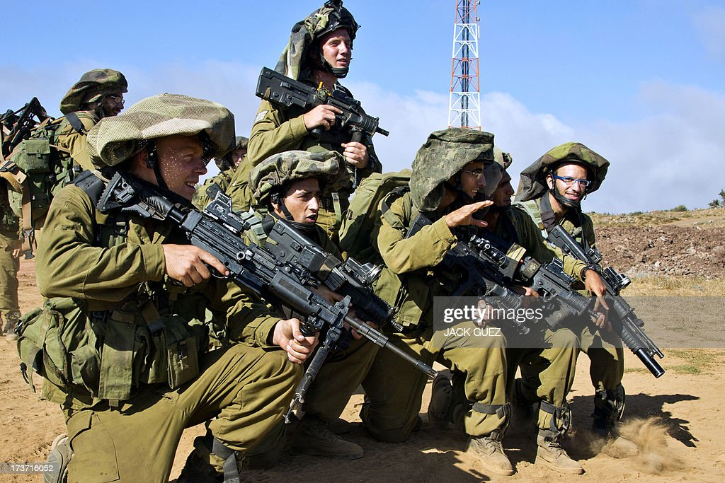 Israeli soldiers from the Golani Brigade take part in a military training in the Israeli-annexed Golan Heights near the border with Syria on July 17, 2013. Gunmen from Syria infiltrated a disused army outpost in the Israeli-occupied area of the Golan Heights just beyond the ceasefire line, a military spokeswoman said. The incident came a day after several mortar rounds hit the Israeli side of the Golan, causing several fires to break out along the ceasefire line as Syrian rebels battled regime forces near the Quneitra crossing.