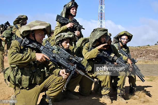 Israeli soldiers from the Golani Brigade take part in a military training in the Israeliannexed Golan Heights near the border with Syria on July 17...